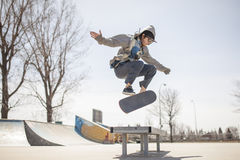 Young skateboard enthusiast doing a kickflip royalty free stock image
