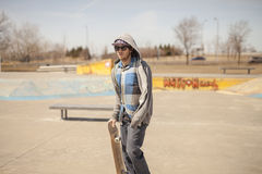 Young skateboard enthusiast in skatepark Stock Photo