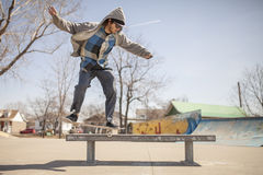 Young skateboard enthusiast in skatepark Royalty Free Stock Image