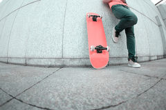 Young skateboard use cellphone Stock Images