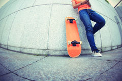 Young skateboard use cellphone Royalty Free Stock Photos