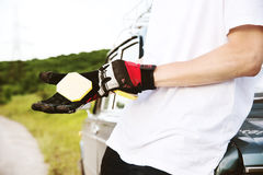 A young skateboarder dresses gloves for slides royalty free stock photo