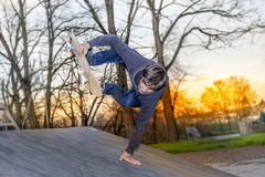 Young skateboarder jumping on a ramp Stock Photo