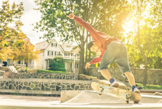 Young skateboarder practicing in the skate park Stock Photo