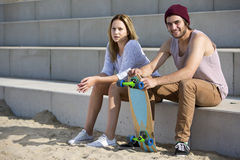 Young Skateboarding Couple On A Beach Stock Photography