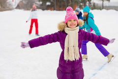 Young skater girl on the ice Stock Photos