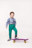 Young skater isolated on white Stock Photography