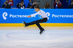 Young skater male performance in short program item Sit spin. Chelyabinsk, Russia -  January 21, 2016: young skater male performance in short program item Sit Stock Image