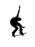 Young skater on skateboard. Vectored illustration as silhouette of skater boy performing a trick on his skateboard Stock Photo