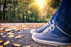 Young skater wearing trendy sneakers Royalty Free Stock Photography