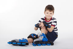 Young skater on white background Royalty Free Stock Photo
