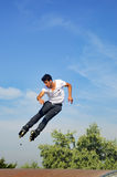 Young skaters under the blue sky seems almost like flying. Istanbul, Turkey - June 4, 2016: Avcilar Skatepark. In the area of 2000 square meters skatepark, young royalty free stock image