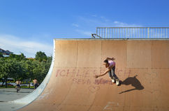 Young skaters under the blue sky seems almost like flying. Istanbul, Turkey - June 4, 2016: Avcilar Skatepark. In the area of 2000 square meters skatepark, young royalty free stock photo