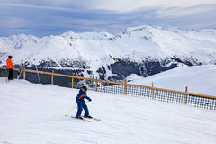 Young skier enjoy skiing at the slope in the Austrian Alps Royalty Free Stock Photos