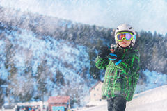 Young skier in full ski equipment in ski areal Stock Photo