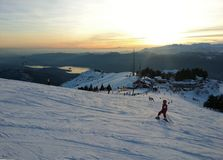 Young Skier going down the slope at Monterone Alps Royalty Free Stock Images