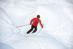 Young skier off-piste backcountry freeride. Young skier on off-piste slope. Backcountry or freeride skiing Royalty Free Stock Photos