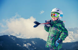 Young skier portrait in snowy mountain Royalty Free Stock Images