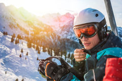 Young skier sitting in cabin on ski resort. Alps Royalty Free Stock Images