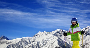 Young skier with on snow mountains at sun winter day Stock Photos
