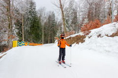 Young skier on start of a piste Royalty Free Stock Images