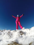Young skier on the top of snowy mountain Royalty Free Stock Images