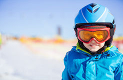 Young skier wearing safety helmet and goggles Royalty Free Stock Photo