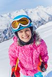 Young skier in winter resort. Skiing, winter, child - young skier in winter resort Stock Photography