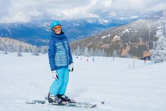 Young skier in winter resort. Skiing, winter, child - young skier in winter resort Stock Photo