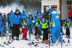 Young skiers preparing to ski in Bansko, Bulgaria Stock Photos
