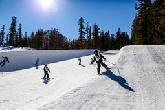 Young kids Ski/Snowboard the mini half-pipe at Mammoth Mountain, California USA Stock Image