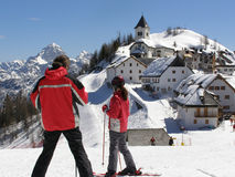 Young skiers viewing panorama stock image