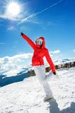 Young skiing girl or woman posing against winter landscape Stock Photography