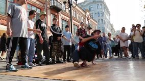 Young skilled hip hop dancer performingg street