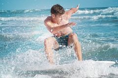 Skimboarding young man ocean. Young skimboard surfer rides the ocean waves Stock Photography