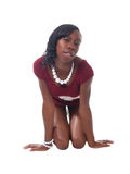Young skinnny black woman in red knit dress. Young black woman kneeling in short red dress Stock Image