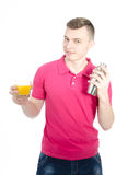 Young skinny bartender with shaker. Man on white background holding a cocktail shaker. Summer and holidays. Youth and fun stock photos