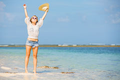 Young skinny caucasian girl at the beach waving Stock Photo