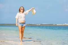 Young skinny caucasian girl at the beach waving Stock Images