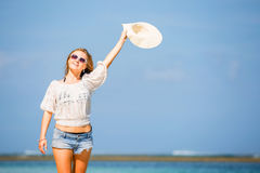 Young skinny caucasian girl at the beach waving Stock Image
