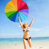 Young skinny girl in blue shorts with colourful Royalty Free Stock Photo