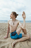 Young skinny man practices yoga Royalty Free Stock Image