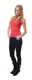 Young skinny woman. Full length body shot of a cool young woman wearing jeans and tanktop Royalty Free Stock Images