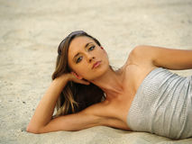 Young Skinny Woman Reclining In Sand Confident Stock Photography