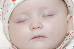 Young sleeping baby girl. A 12 week old young baby girl sleeping stock images