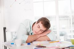 Young sleeping businessman while working day Stock Photography