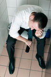 Young sleeping drunk man on the toilette Royalty Free Stock Photos