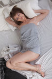 Young sleeping woman in bedroom. Royalty Free Stock Photography