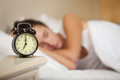 Young sleeping woman in bedroom. Stock Photography