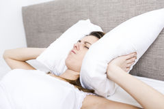 Young sleeping woman in bedroom at home wearing in white Royalty Free Stock Photography